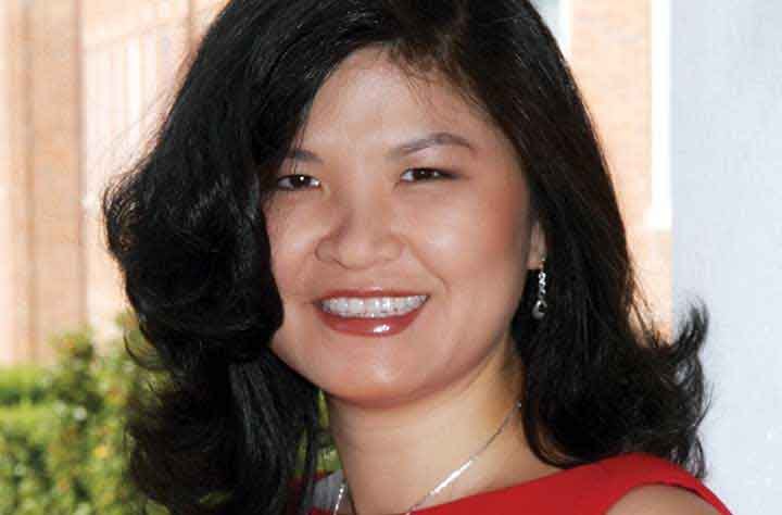 Alumnae BETTY LO '95 smiles for the camera