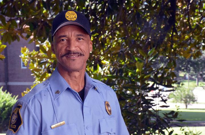 Policeman Gerald Smith smiles for the camera