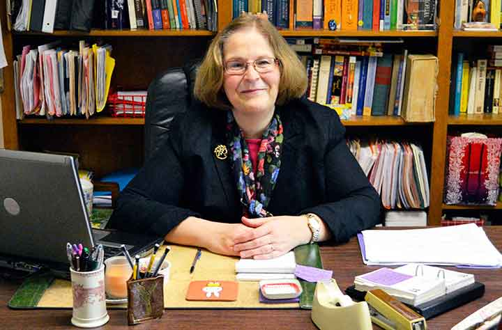 Regina B. Oost sitting at her desk in her office