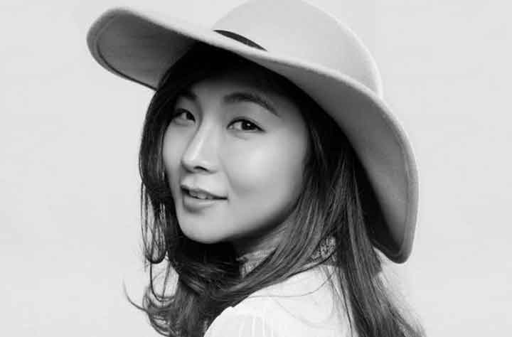 Sherry Li smiles with hat on
