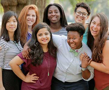 Seven Wesleyan students are posing for picture