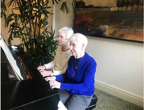 Alumnae at piano