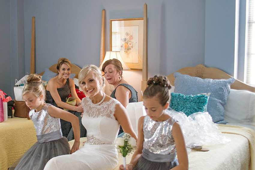 Bridal party hanging out in a bedroom on campus that you can rent out
