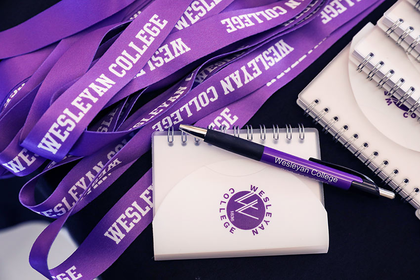 Notebook and lanyards with wesleyan logo