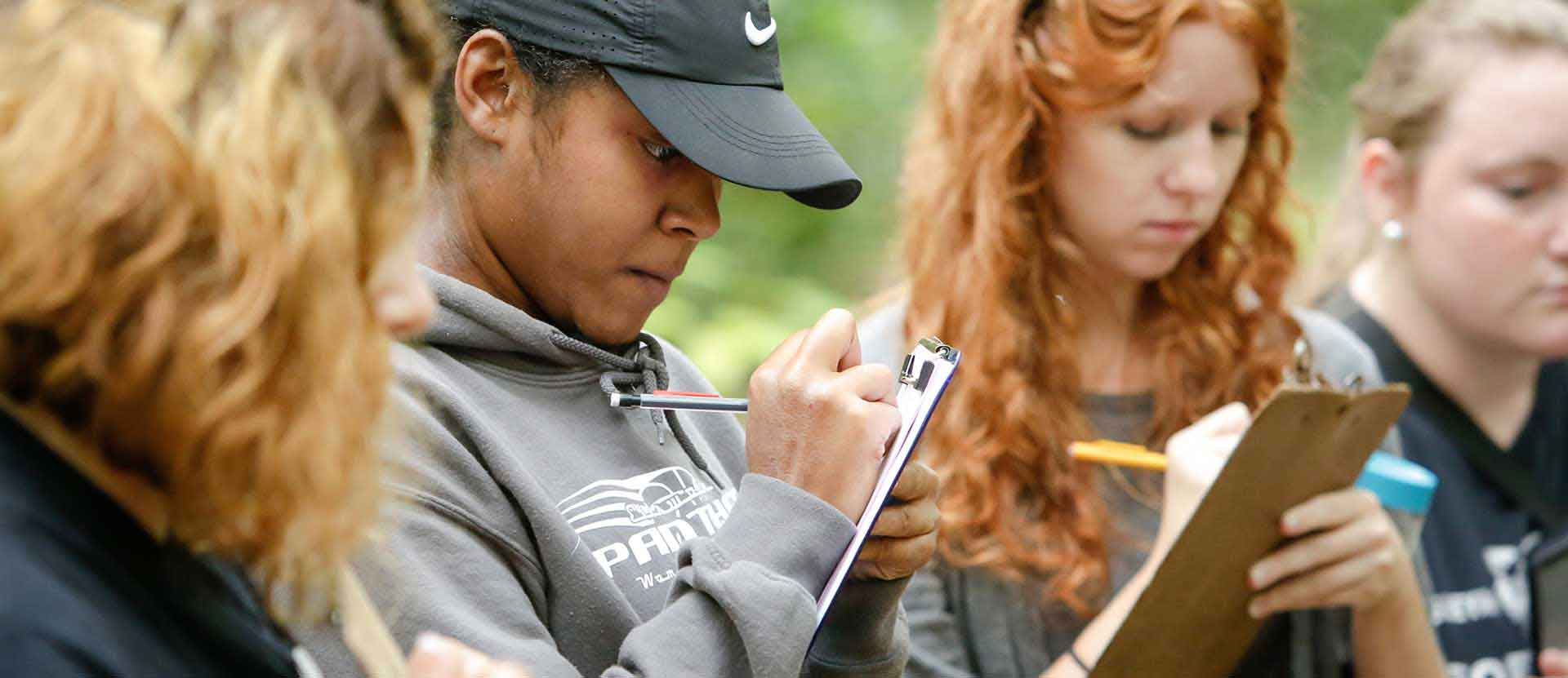 Students collect data from the Arboretum