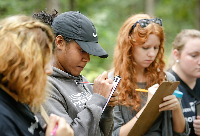 Enviromental Studies students collect data in the Arboretum.