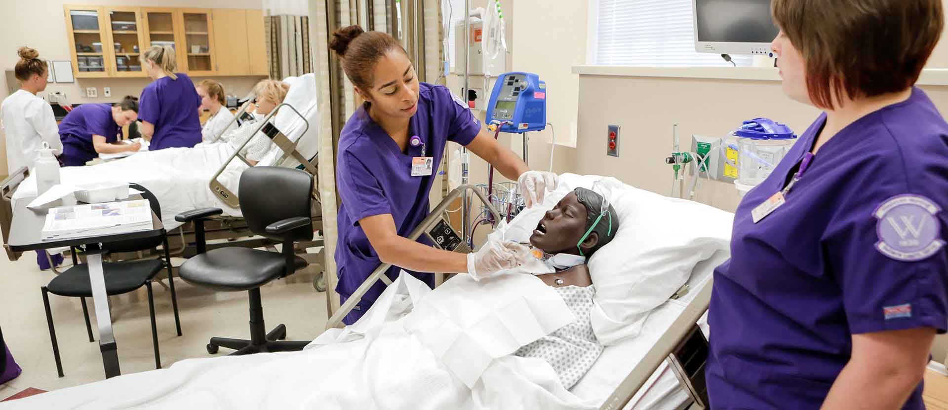 Nursing students practice procedures in Nursing Lab
