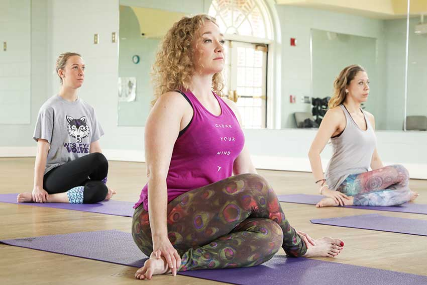 Three women breathing during yoga class.